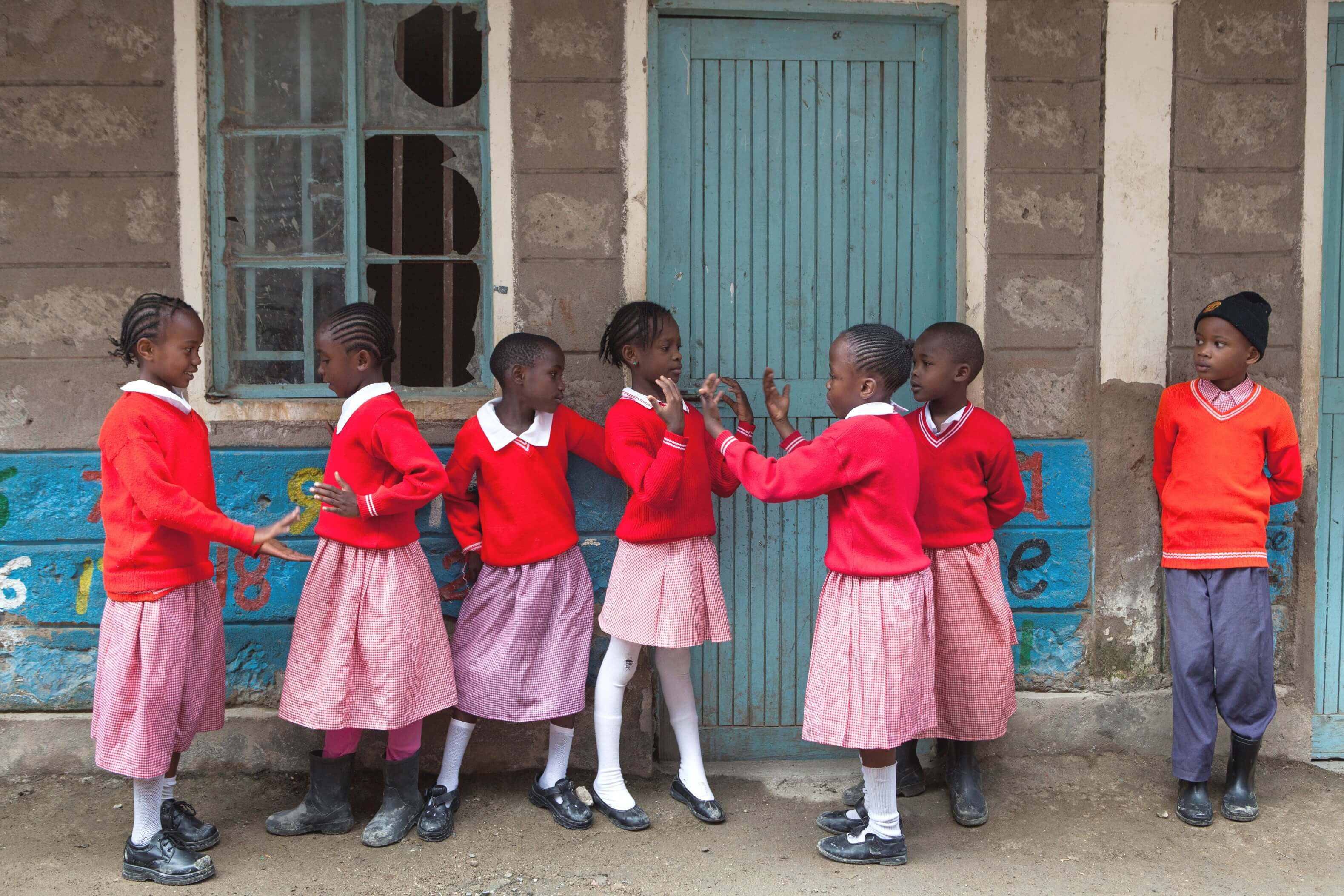 Students outside a school in Kenya supported by the Education for Marginalized Children in Kenya project