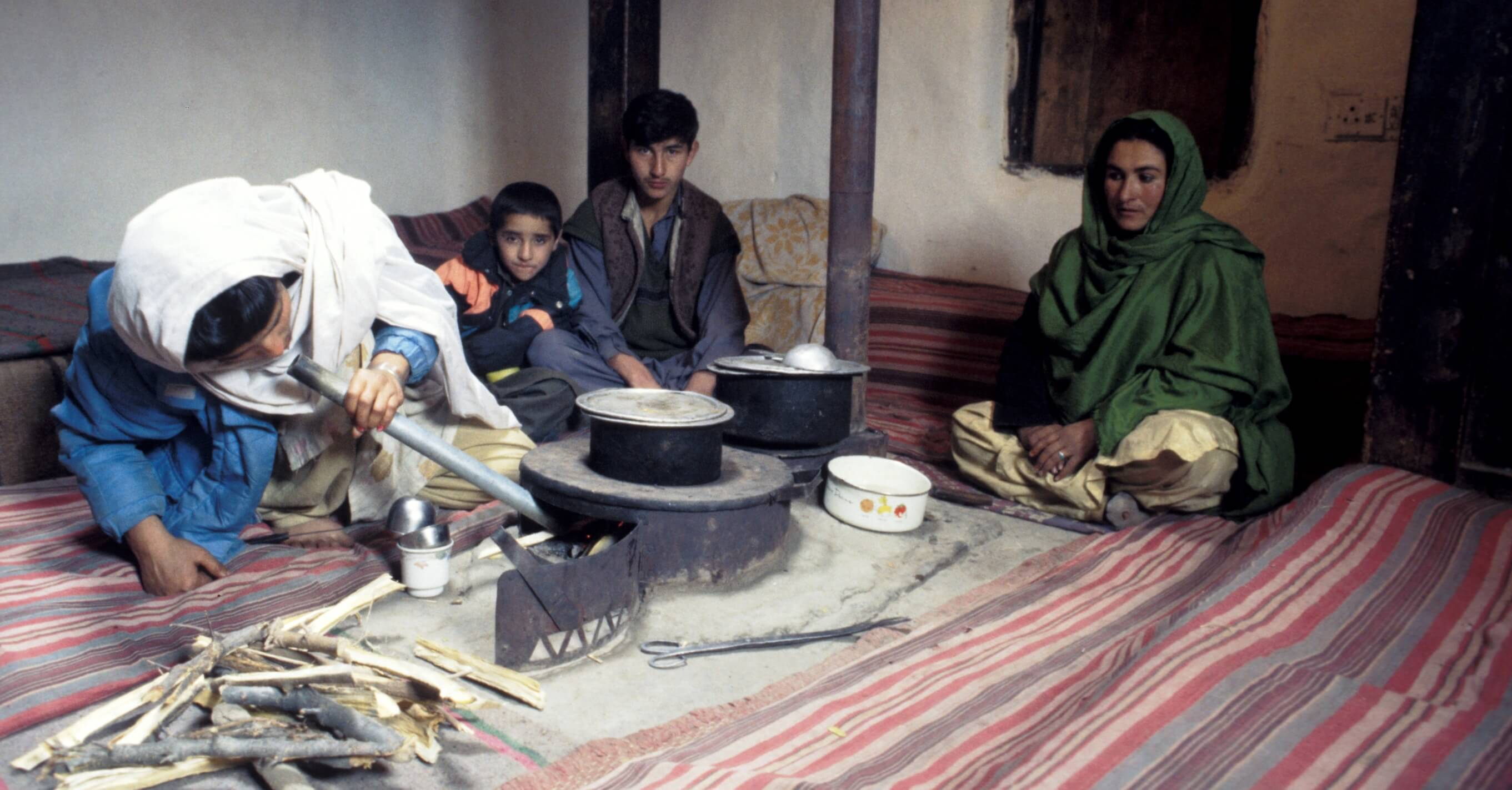 A family using their new environmentally friendly stove in Pakistan